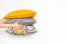 Colorful Pillows In Women's Ha...