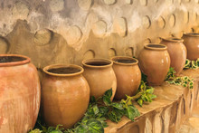 Old Clay Pots Standing In A Ro...