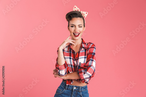 Fototapeta Happy young pin-up woman isolated