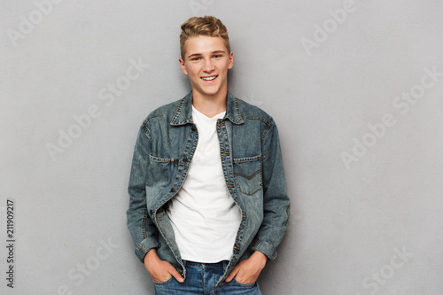 Fotografiet  Portrait of a smiling casual teenage boy