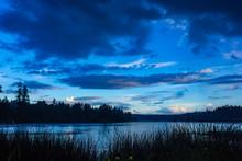 Black Landscape Below Dark Clouds At Dusk