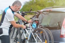 Man Loading Bicycles On The Bi...