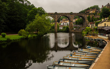 View Of The Nidd River, The Old Bridge And Rowing Boats From The Ruins Of Knaresborough Castle In A Cloudy Day. Beautiful Village Of England.
