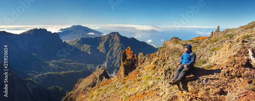 Staande foto Nachtblauw Resting man watching a landscape above the crater Caldera de Taburiente, Island of La Palma, Canary Islands, Spain