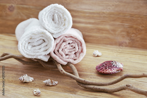 Spoed Foto op Canvas Spa Pile of cotton towels on wooden background with copy space. Selective focus. Spa concept from natural items.