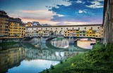 Famous bridge Ponte Vecchio on the river Arno in Florence, Italy. Evening view.