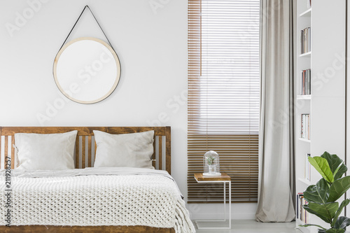 Beau Window With Wooden Blinds And Light Grey Curtain In White Bedroom Interior  With Mockup Poster, Double Bed And Rack With Books