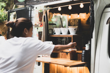 Selected Focus Drip Coffee Cup Woman Buying A Coffee From A Coffee Food Truck