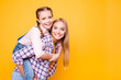 canvas print picture - Laugh emotions long hair girlish pigtails checkered shirt concept. Side profile close up view portrait of two excited cheerful rejoicing cute sweet pretty older sisters isolated on bright background