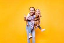 Mama Mom Older Siblings Game Parenthood Youth Concept. Portrait Of Dreamy Beautiful Mommy Holding Carrying Her Excited Cheerful Cute Sweet Lovely Girl On Back Isolated On Bright Vivid Background
