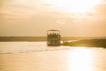 Boat On River At Sunset, Chobe...