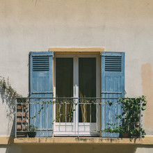 Bright Blue Shutters Balcony In Provence, France