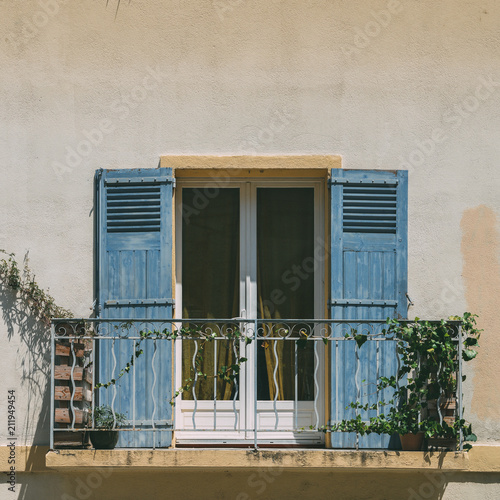 bright-blue-shutters-balcony-in-provence-france