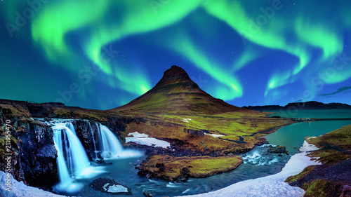 Fotobehang Noorderlicht Northern Light, Aurora borealis at Kirkjufell in Iceland. Kirkjufell mountains in winter.