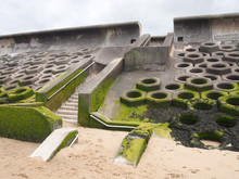 The Seawall South Of Blackpool Constructed Of Concrete Honeycomb Type Structures With Steps Leading To The Beach Covered In Tidal Seaweed
