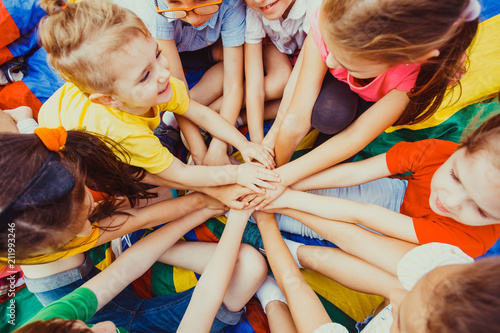 Fotografía  Group of children putting their hands together