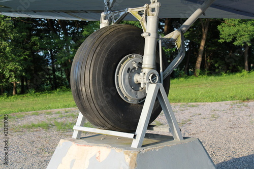 Photo  Right tire of Douglas Dakota DC-3 C-47 WWII plane exhibit in local forest positi