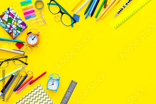 Photo sur Toile Pays d Asie Education concept. Stationery for school pupil mockup with glasses and notebook on yellow background top view copy space