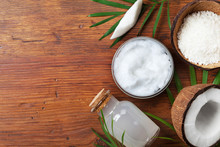 Organic Coconut Products For Spa Treatment, Cosmetic Or Food Ingredients. Oil, Water And Shavings On Wooden Table Top View. Flat Lay.