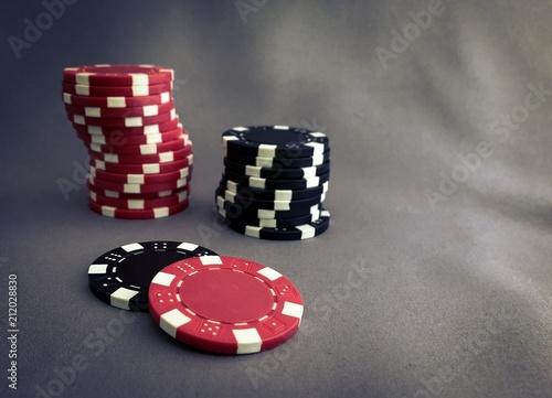 Poker chips on grey плакат
