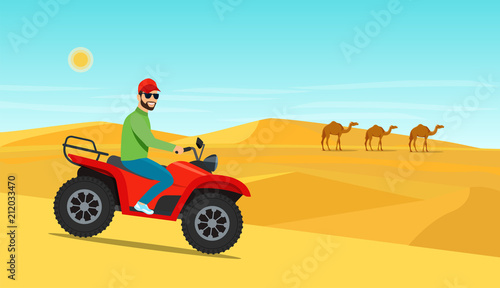Fotografering  Young man riding on the ATV motorcycle in desert