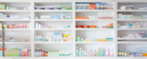 Fotobehang Apotheek Pharmacy drugstore blur abstract backbround with medicine and healthcare product on shelves