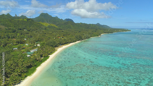 Fotografie, Obraz  AERIAL: Flying along idyllic sandy beach and oceanfront houses on remote island