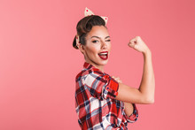 Gorgeous Strong Young Pin-up Woman Showing Biceps.