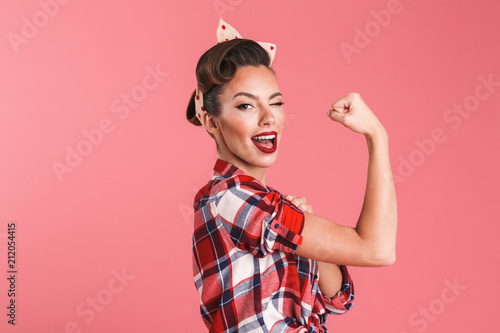 Fotografija Gorgeous strong young pin-up woman showing biceps.