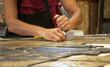 Glazier restoring antique glass window