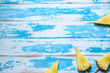 Pineapples on ice cream sticks on wooden background. Minimal summer concept.
