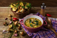 Mushroom Soup In Red Bowl And Wicker Basket On The Rustic Table