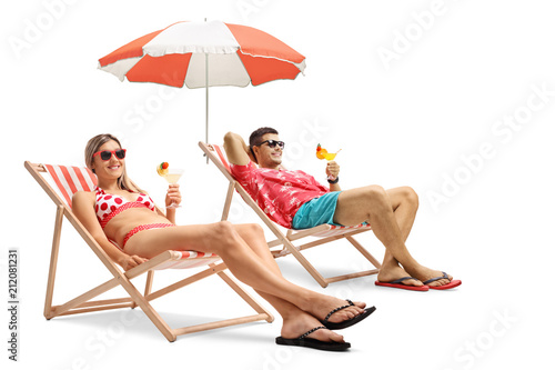 Tourists with cocktails sitting in deck chairs Canvas Print
