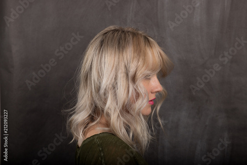 Fotografie, Obraz  Woman With Medium Shadow Root Blonde Hairstyle