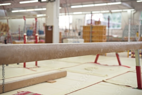 Spoed Foto op Canvas Gymnastiek Gymnastics Hall. Gymnastic equipment.Beam