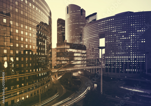 Poster Stad gebouw Office buildings in Paris business district La Defense. Sskyscrapers glass facades. Modern urban architecture, economy, finances, business activity concept