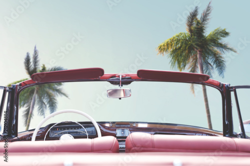 Keuken foto achterwand Vintage cars Summer car and background of palms and sea.