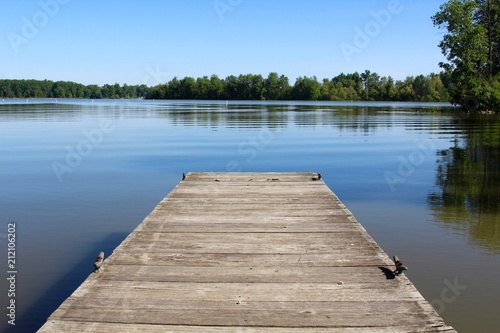 The small wood dock and the reflection lake of the park. Fototapeta
