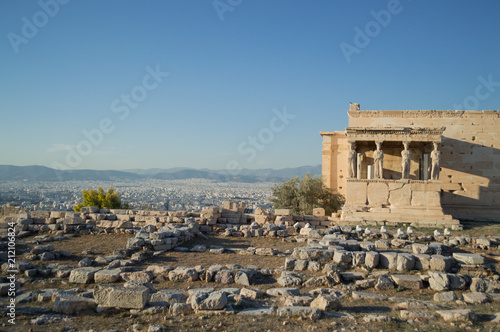 Spoed Foto op Canvas Athene Ruin of a Temple at the Acropolis with Athens Backdrop, Greece
