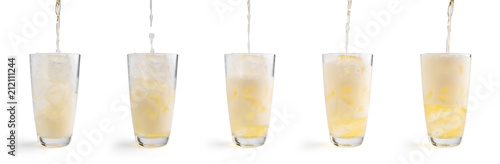 Foto op Plexiglas Bier / Cider Pouring beer into glass, isolated on white background. Clipping Path