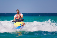 Happy, Excited Family, Father And Son Having Fun On Jet Ski At Summer Vacation