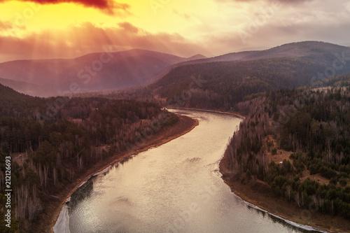 Staande foto Chocoladebruin Autumn river landscape, top view, Mansky loop, Krasnoyarsk, Russia.. Toned orange.