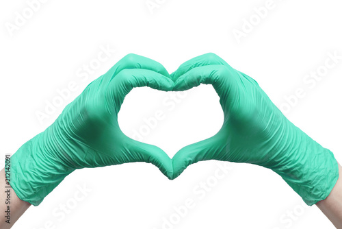 Valokuva  Heart made of green medical gloves isolated on white background