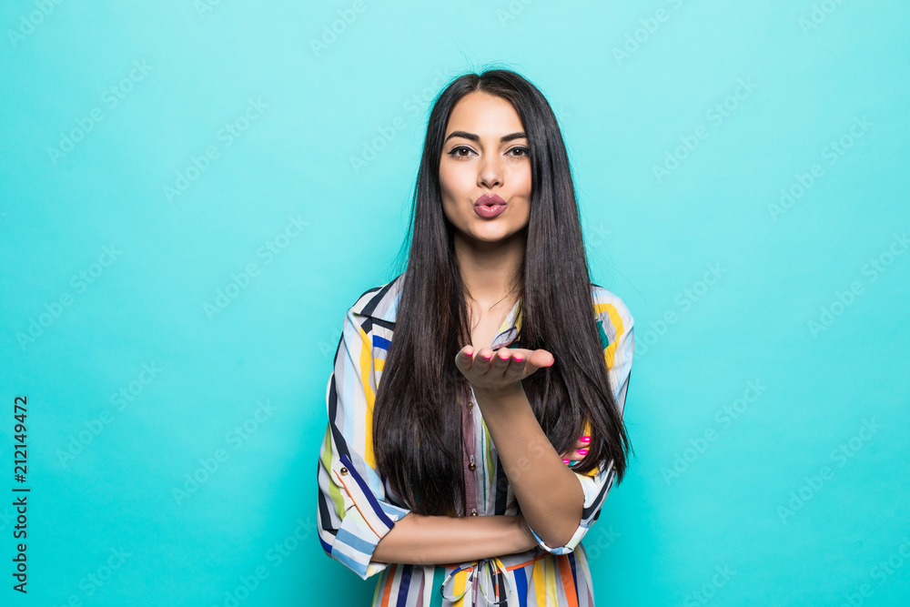 Fototapety, obrazy: Portrait of young cute woman blowing kiss at camera isolated on the blue background