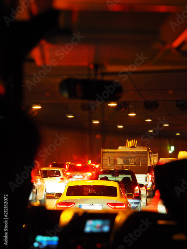 Photo Stands Motor sports Traffic jam in automobile tunnel. View through the windshield of the bus. Tunnel in Europe