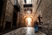 Woman Tourist Sightseeing In Barcelona Barri Gothic Quarter And Bridge Of Sighs In Barcelona, Catalonia, Spain..