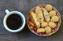 Traditional Italian Cantuccini And Amaretti Cookies With Almond And Cup Of Coffee On Old Wooden Background.Selective Focus.