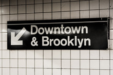 Downtown & Brooklyn Sign In A Subway Station In Manhattan, New York City.