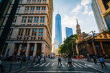 Fototapeta Nowy Jork - Pedestrians and buildings at Fulton and Broadway, in Manhattan, New York City
