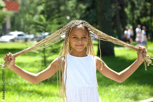 beautiful girl holding on to her long braids